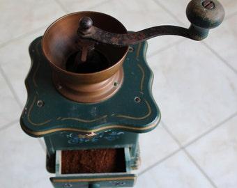 Old hand painted coffee grinder