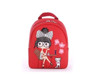 Children bag, backpack. Girl with a cat