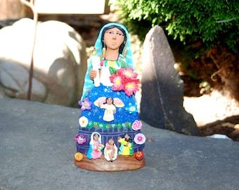 Josefina Aguilar, Oaxaca's Folk Art Nativity w/ Gloria Angel & Flowers on a Zapotec Woman's skirt holding Poinsettias and Christmas Candle