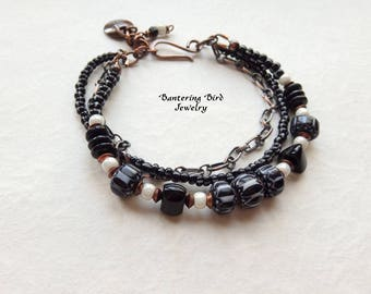 Classic Black and White Bracelet, Glass Chevron Beads, Multi Strand, Copper Chain and Charm, Bohemian Jewelry
