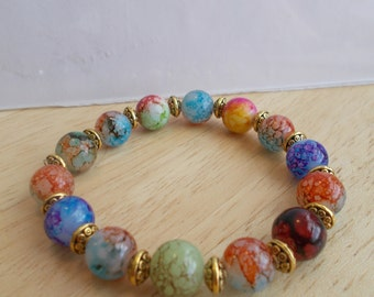 Stretch Bracelet made with Multi Color Marbled Glass Beads and Gold Spacer Beads