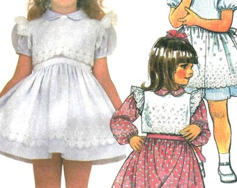 McCalls 9478 Sewing Pattern Childs Ruffle and Lace Dress with Peter Pan Collar Puff Sleeves and Ruffle Armhole Eyelet Vest sz 2 thru 4 Uncut