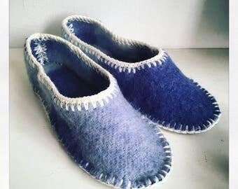 Warm wool slippers in a vintage blanket.
