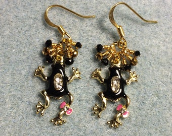 Black, gold, and pink enamel and rhinestone frog charm earrings adorned with tiny dangling black and gold Chinese crystal beads.