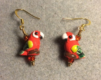 Small red, green, and yellow ceramic parrot bead earrings adorned with red Chinese crystal beads.