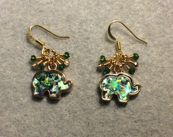 Gold and imitation opal elephant charm earrings adorned with tiny dangling green and gold Chinese crystal beads.