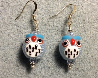 Light blue and white lampwork spotted owl bead earrings adorned with light blue Chinese crystal beads.