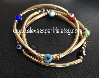 Set of three gold plated bracelets with glass eye beads- Set de tres pulseras en laminado de oro con piedras de ojitos