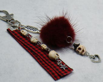 Red and black Gothic bag to the fur ball