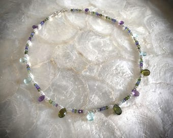 gemstone necklace with moss and green aquamarine tourmaline tanzanite amethyst and sterling silver beads