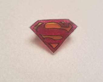 Superman style pin