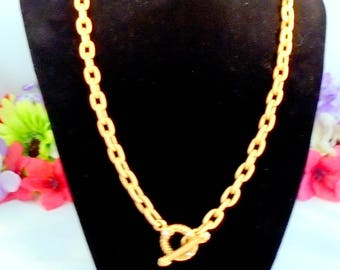Jay Strongwater Goldtone Necklace with Rhinestones on the Toggle Clasp. The Necklace measures 19 inches long.