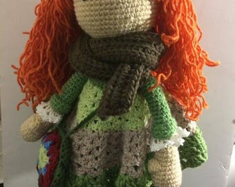 Amigurumi doll with purse and scarf