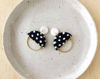 Silhouette Earrings - White Granite & Black/White Pattern with a Brass Semi Circle Silhouette.