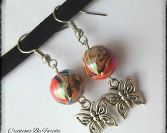 wave earrings with a butterfly pendant and Pearl orange effects