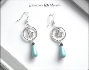 Nice pair of earrings with a drop Pearl blue hanging from a ring and a star
