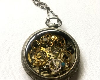 Filigree carved steampunk pocket watch filled with resin