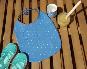 Oval shaped blue bib with white dots