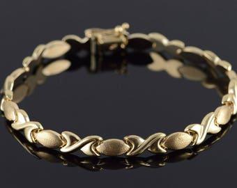 """10k Hollow Criss Cross Bracelet Gold 7.5"""""""