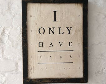 "Framed wooden sign with ""I only have eyes for you"" quote"