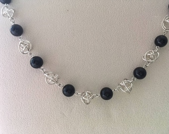 Black onyx bead and silver knot bead necklace.