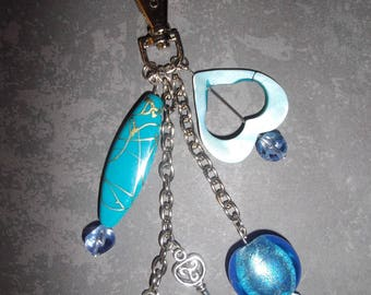 bag charm with beads in shades of blue and silver metal charms