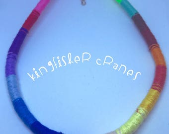Handmade multicolour cotton and rope necklace.