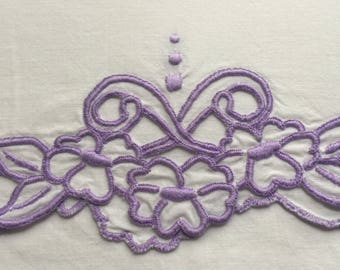 Vintage pillowcase with purple embroidery