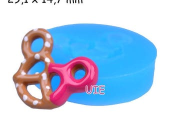 silicone mold for pretzel salted with polymer clay keychain