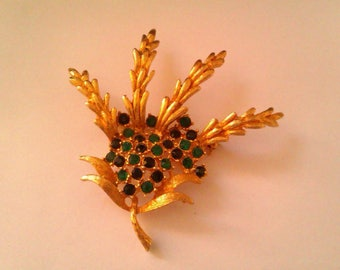 vintage gold coloured heather brooch with green stones