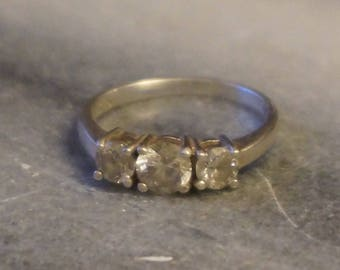Silver Beautiful engagement ring with 3 cubic zirconia. size 6, and 2,45 gram