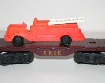 Vintage 1960's MARX 'Erie' Flat Car O-Gauge Train Car with Plastic Fire Engine Load