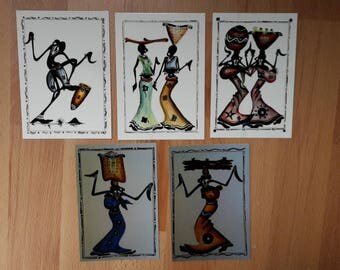 African postcards of African women carrying wood and fruit; African culture; cards Africa