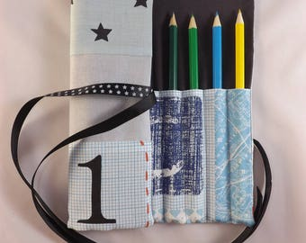 Package is customizable rolling markers or color pencils for boy