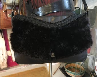 Bag made of genuine leather and mink fur, recycled leather Arrogance