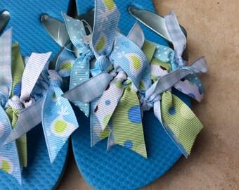 Girl's blue Flip Flops with ribbon
