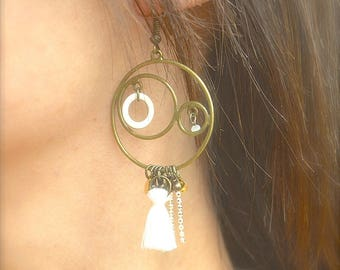Bronze rings, white tassel earrings