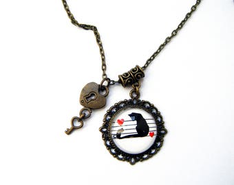 Black Cat on a range of music pendant