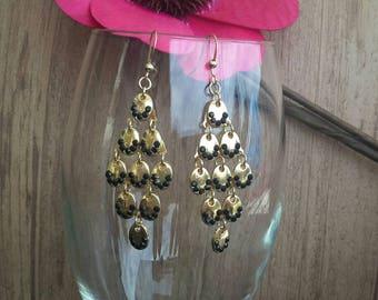 Gold and black dangle earrings