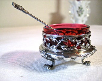 Pair of salt cellars with their silver spoons.