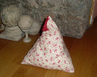 Door holder made of floral cotton fabric stuffed with wadding and weighted with rice.