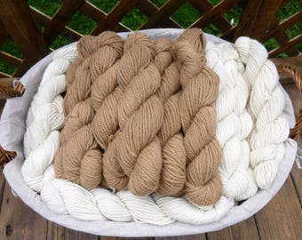 100% Alpaca Yarn, 3 ply bulky weight, 100 yards/skein; 2 natural (undyed) colors: Creamy White and Golden Fawn; 3.8 oz/skein (+/-)