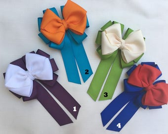 Hair Bow and cold porcelain clay bow center with french barrette at the back
