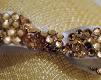 Fabulous Itty Bitty Swarovski encrusted baby bow. Available on clip or skinny elastic headband