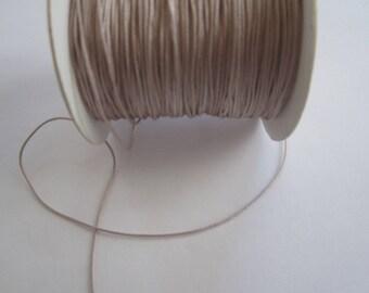 1 meter of 0.8 mm nude beige nylon thread