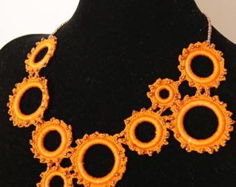 Crochet necklace, with orange cotton yarn, embellished with beads