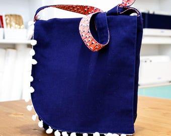 Navy blue girl shoulder bag decorated with tassels