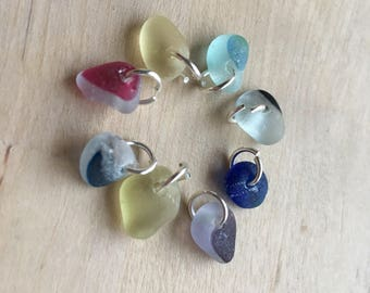 8 x tiny genuine sea glass pieces from Seaham. Shades of blue, purple, red and yellow. Top drilled. Ideal charms, bracelet, necklace