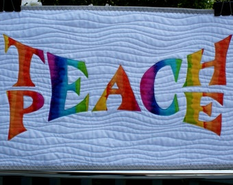 "Teach Peace quilted wallhanging in rainbow colors 14"" x 24"""