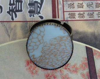 Adjustable ring, light blue Japanese paper and golden flowers.